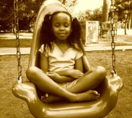 af-am-girl-meditating-in-swing-for-site